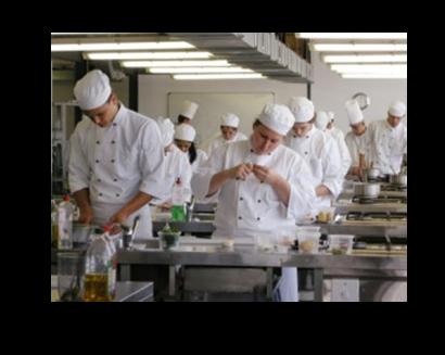 a dozen chefs working in large kitchen